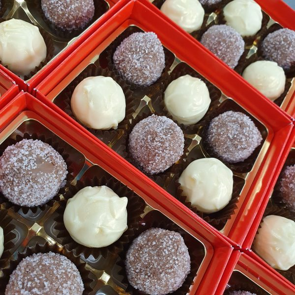 box of white and strawberry champagne truffles