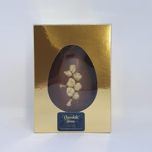 small milk easter egg with hazelnuts